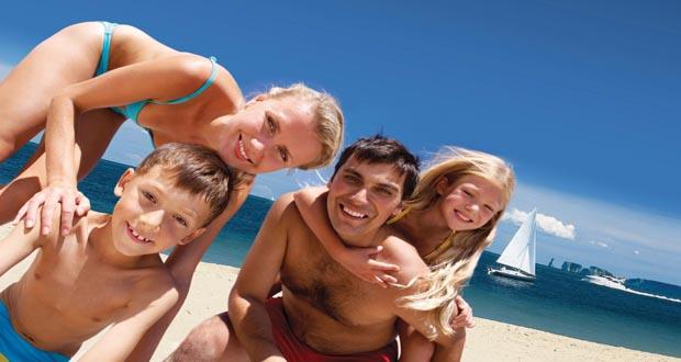 Rumsey-Holiday-Homes-Family-on-Sandbanks-Beach