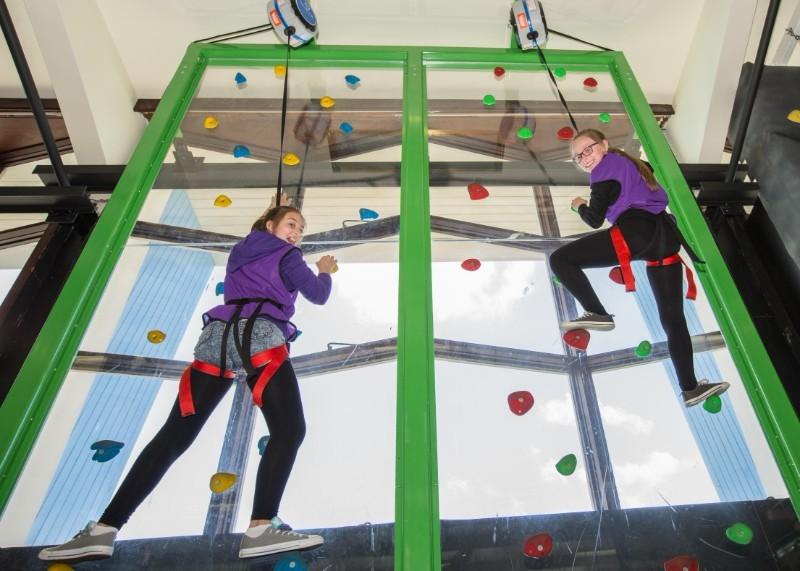 Teenagers-on-climbing-wall