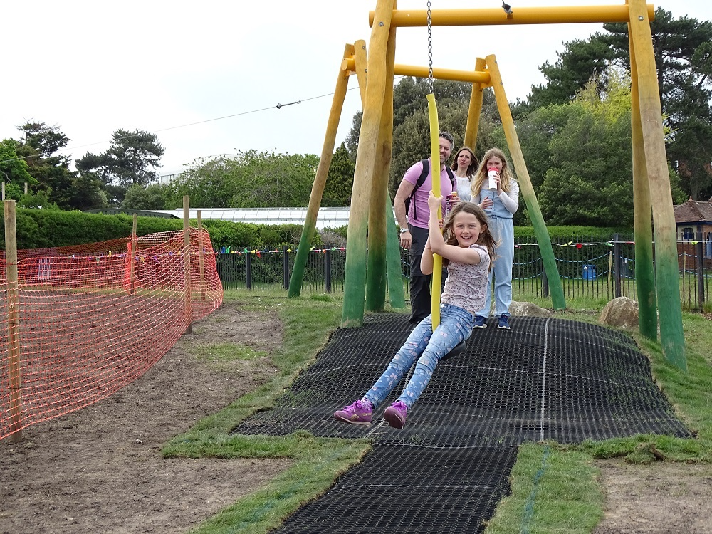 A family having fun on the zip wire